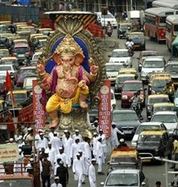 Ganesha in procession and traffic