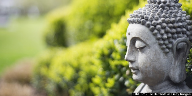 The Buddha in a garden setting