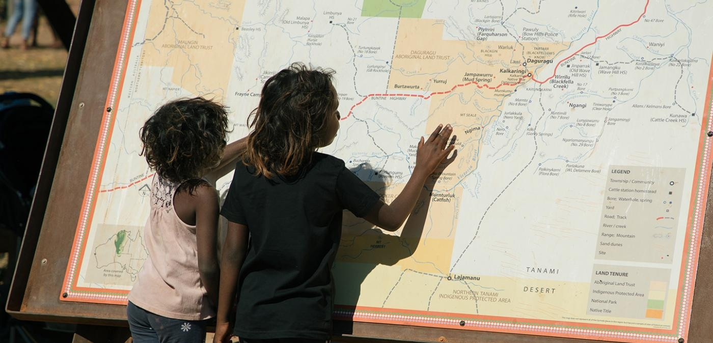 Children looking at the map of the walk off